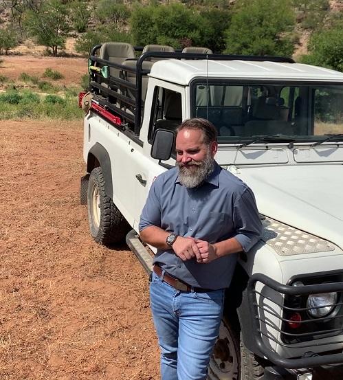 Dr Benji Pretorius next to a jeep