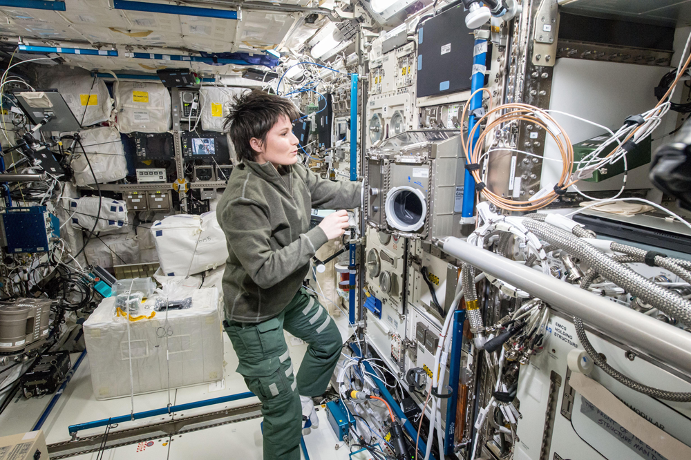 ESA-Astronaut Samantha Christoforetti preparing BIOLAB of the COLUMBUS module for the TRIPLE LUX experiment. Credit: NASA